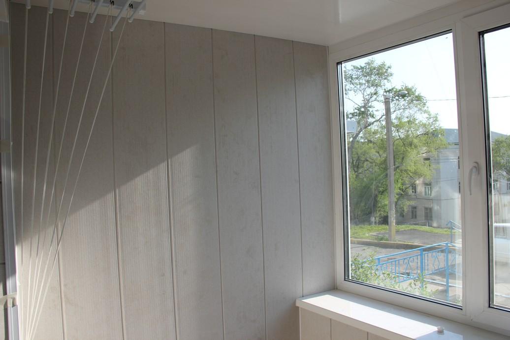Внутренняя отделка балконов и лоджий панелями пвх во арханге.